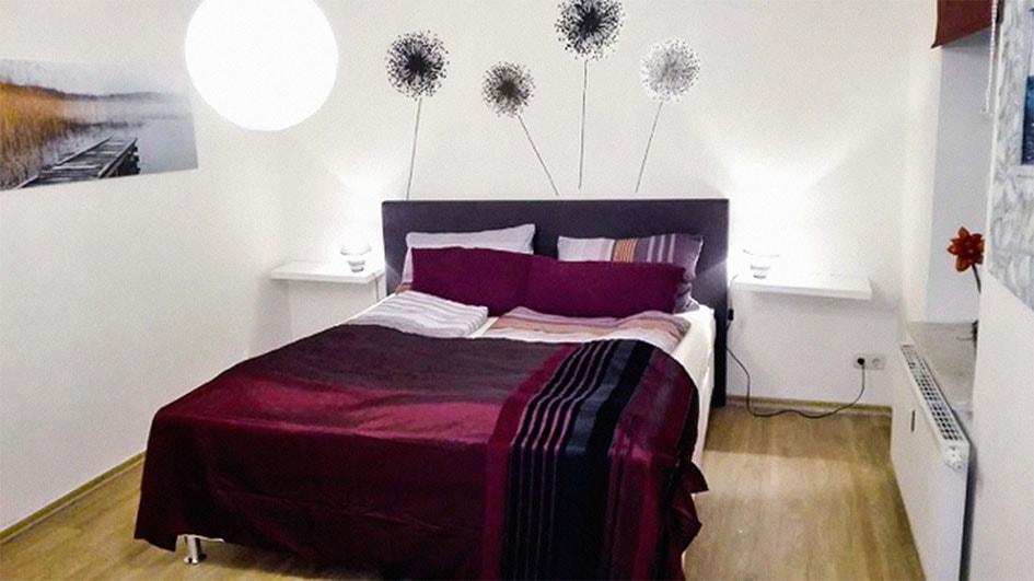 Pension M14 Wohnen auf Zeit Schlafzimmer Doppelbett